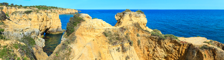 Summer Atlantic rocky coast landscape (Albufeira outskirts, Algarve, Portugal). Two shots stitch high-resolution panorama. Stock Photo