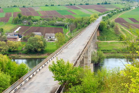 Top picturesque view of Ustechko bridge thrue Dnister river canyon. Spring, Ternopil region, Ukraine, Europe.