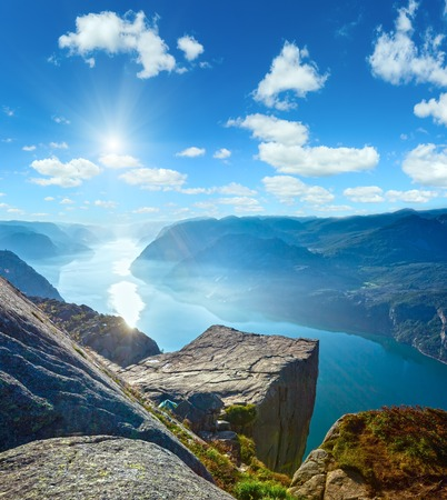 Preikestolen massive cliff (Norway, Lysefjorden summer morning sunshiny view)