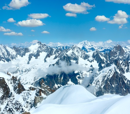 Mont Blanc mountain massif summer landscape with blue cloudy sky (view from Aiguille du Midi Mount, France )