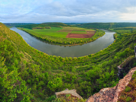 Top evening view of the Dnister river bend canyon, with spring fields on coast. Ternopil region, Ukraine, Europe. Four shots stitch high-resolution panorama.