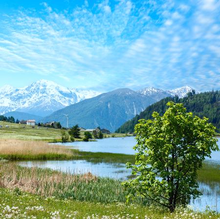dandelion snow: Summer mountain landscape with lake Lago di Resia (Italy) Stock Photo