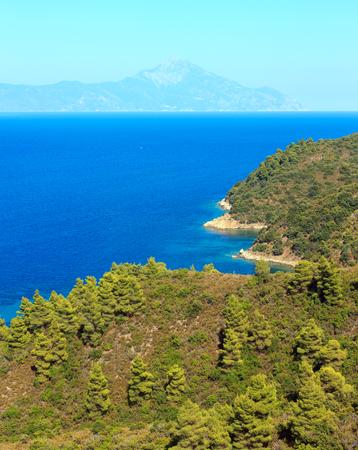 Aegean sea coast landscape and Mount Athos in mist (Chalkidiki, Greece). Three shots stitch image.