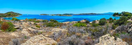 Beautiful summer Aegean Sea rocky coast landscape, Sithonia (near Lagonisi beach), Halkidiki, Greece. Three shots stitch panorama.