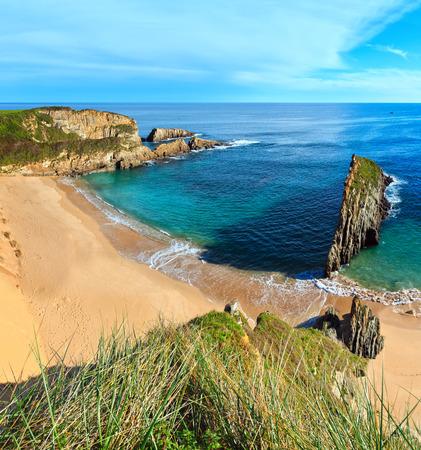 Sandy Mexota beach and pointed rock near (Spain). Atlantic Ocean coastline landscape. Two shots stitch image. Stock Photo