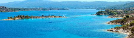 Beautiful summer Aegean Sea coast landscape (near Lagonisi , Sithonia, Halkidiki, Greece). Three shots stitch high-resolution panorama.
