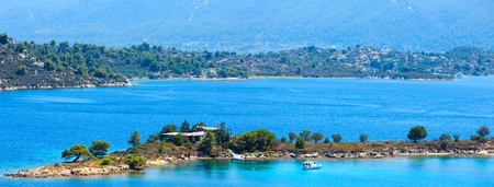 Beautiful summer Aegean Sea coast landscape (near Lagonisi , Sithonia, Halkidiki, Greece). Two shots stitch high-resolution panorama.
