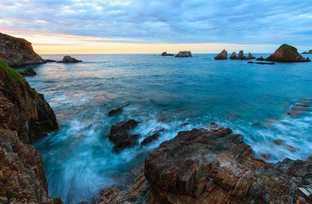 Evening Atlantic ocean coastline landscape. Beautiful Gueirua beach with sharp islets. Asturias, Spain.