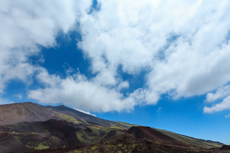 Summer Etna volcano mountain craters and blue cloudy sky, Sicily, Italy. Stock Photo