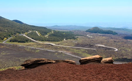Serpentine road from summer Etna volcano mountain, Sicily, Italy