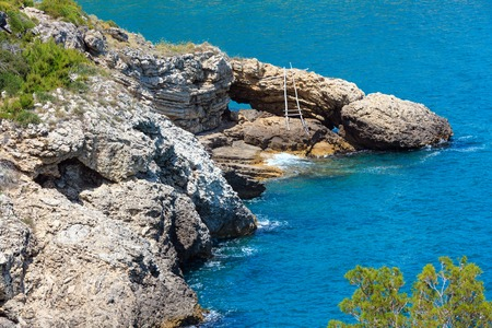 Summer coast near Architello (Arch) of San Felice on the Gargano peninsula in Puglia, Italy