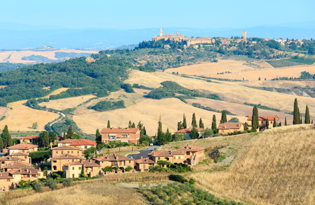 Beautiful landscape of Tuscany summer morning countryside in Montepulciano region. Typical for the Italy region Toscana farm houses, hills, wheat field, olives garden, vineyards, cypress passes. Reklamní fotografie