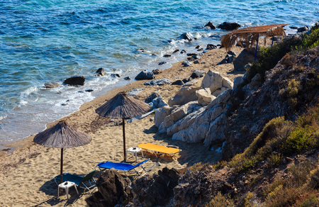 Summer sea scenery with transparent water and sandy beach. View from shore (Sithonia, Halkidiki, Greece).