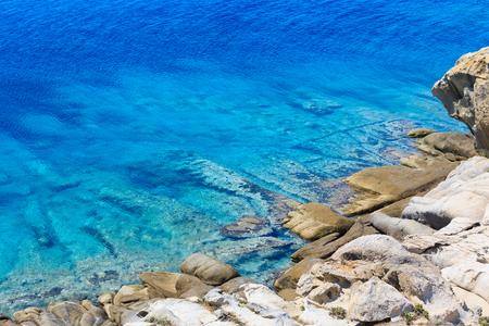 Summer stony Aegean sea coast (Halkidiki, Sithonia, Greece).