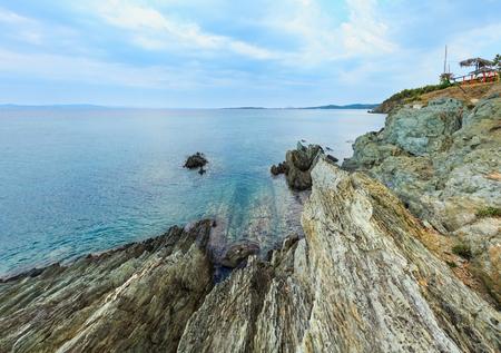 Summer morning sea landscape, view from rocky shore near Tristinika beach (Sithonia, Chalkidiki, Greece).