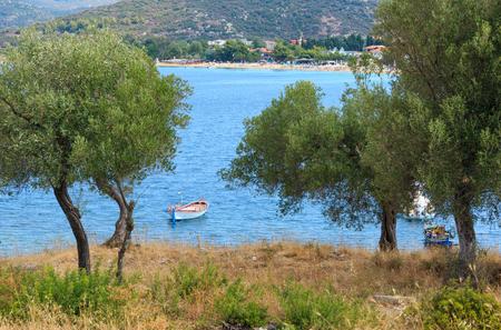 Summer sea coast landscape with boats(Toroni, Halkidiki, Sithonia, Greece).