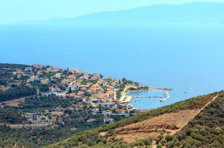 Summer Aegean sea coast top view. The Pyrgadikia village on shore (Sithonia, Halkidiki, Greece). Stock Photo