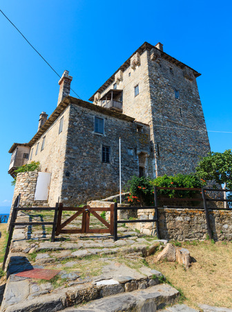 Old tower on coast (Ouranoupoli, Chalcidice, Greece). Stock Photo - 87251552