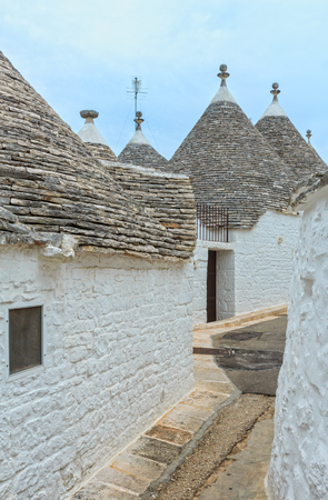 Trulli houses in main touristic district of Alberobello beautiful old historic town, Apulia region, Southern Italy