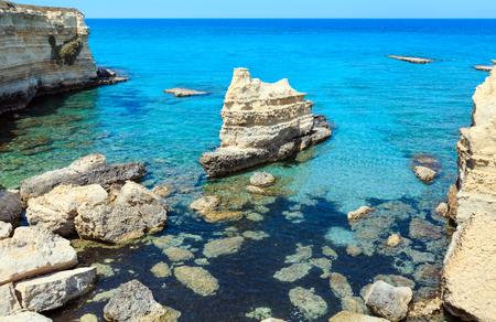Picturesque seascape with white rocky cliffs, sea bay, islets and faraglioni at beach Spiaggia della Punticeddha, Salento Adriatic sea coast, Puglia, Italy Stock Photo