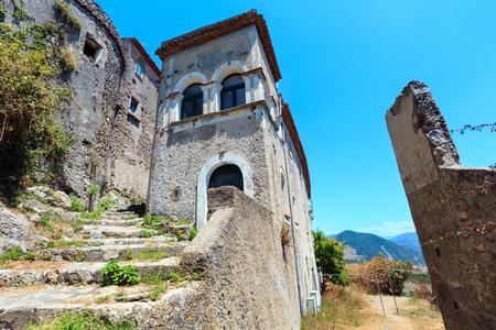 The ruins of the original settlement of Maratea on a rocky escarpment just below the Christ the Redeemer statue on San Biagio mountain, Tyrrhenian sea coast, Basilicata, Italy. Stock Photo