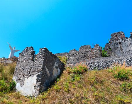 The ruins of the original settlement of Maratea on a rocky escarpment just below the Christ the Redeemer statue on San Biagio mountain,  Tyrrhenian sea coast, Basilicata, Italy
