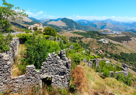 The ruins of the original settlement of Maratea on a rocky escarpment just below the Christ the Redeemer statue on San Biagio mountain, Tyrrhenian sea coast, Basilicata, Italy. Stock Photo