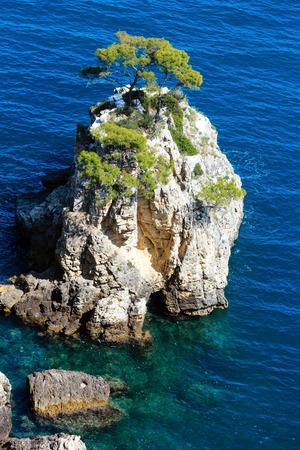 Rock near beach Cala di Porto Greco on the Gargano peninsula in Puglia, Italy. Summer calm beautiful view from Torre dellAglio.