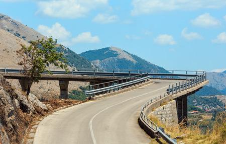 Summer Tyrrhenian sea coast and road to statue of Christ the Redeemer (Cristo Redentore, Maratea, Basilicata, Italy)
