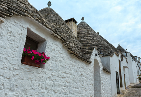 Trulli houses in main touristic district of Alberobello beautiful old historic town, Apulia region, Southern Italy. Stock Photo