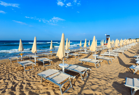 Morning paradise white sandy beach Maldives of Salento with sunshades and sunbeds (Pescoluse, Salento, Puglia, south Italy). The most beautiful sea beach of Apulia. Stock Photo
