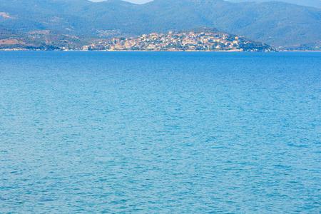 Summer Aegean sea coastline with village on shore (Sithonia, Halkidiki, Greece). Stock Photo