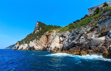 Beautiful medieval fisherman town of Portovenere (UNESCO Heritage Site) view from sea (near Cinque Terre, Liguria, Italy). The Fortress Castello Doria. Stock Photo