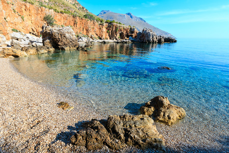 Paradise sea bay with azure water and beach. View from coastline trail of Zingaro Nature Reserve Park, between San Vito lo Capo and Scopello, Trapani province, Sicily, Italy. Stock Photo