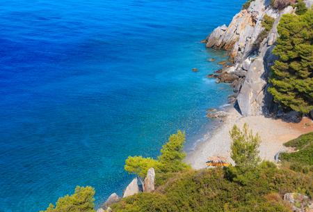 Summer sea coast morning landscape with clear water and beach (Kassandra peninsula, Halkidiki, Greece).