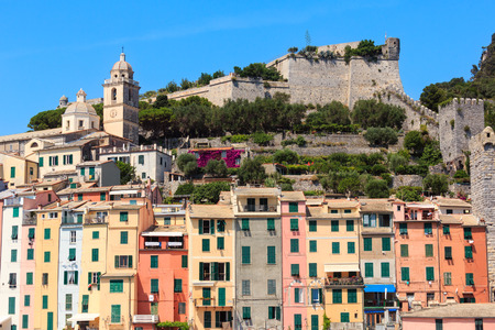 Beautiful medieval fisherman town of Portovenere view from sea (near Cinque Terre, Liguria, Italy). Fortress Castello Doria and church Chiesa di San Pietro. Editorial