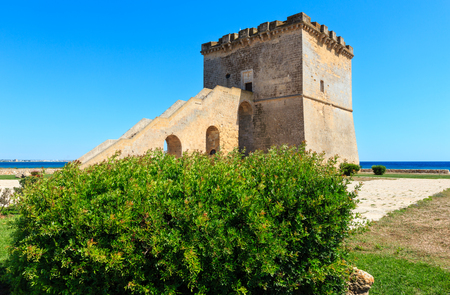 Picturesque historical fortification tower Torre Lapillo (St. Thomas Tower) Torre di San Tommaso on Salento Ionian sea coast, Puglia, Italy