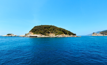 Beautiful rocky sea coast of Palmaria, Tino and Tinetto islands near Portovenere (Gulf of Poets, Cinque Terre National Park, La Spezia, Liguria, Italy). Lighthouse on Tino island. 写真素材