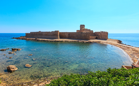 Aragonese castle of Le Castella (build in 474 BC), a fortress on a small islet on Ionian Sea coast, overlooking the Costa dei Saraceni near Capo Rizzuto, Calabria, Italy.