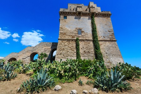 Picturesque historical fortification tower Torre Colimena on Salento Ionian sea coast, Taranto, Puglia, Italy Stock Photo