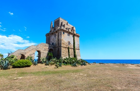 Picturesque historical fortification tower Torre Colimena on Salento Ionian sea coast, Taranto, Puglia, Italy Editorial