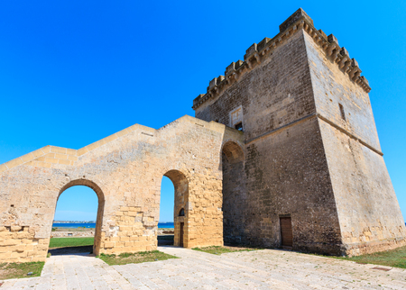 Picturesque historical fortification tower Torre Lapillo (St. Thomas Tower, Torre di San Tommaso) on Salento Ionian sea coast, Puglia, Italy