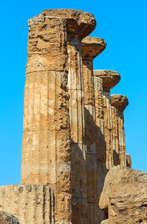 Ruined Temple of Heracles columns in famous ancient Valley of Temples, Agrigento, Sicily, Italy.
