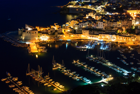 Night view to Tyrrenian sea bay, Castellammare del Golfo town and pier from parking and resting place Localita Belvedere Castellammare del Golfo (Trapani region, Sicily, Italy).