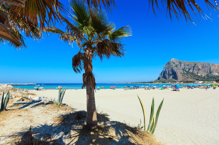 Paradise Tyrrhenian sea bay, San Vito lo Capo beach with clear azure water and extremally white sand, and Monte Monaco in far, Sicily, Italy. People unrecognizable. Stock Photo