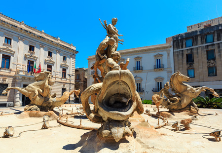 Diana fountain (installed by Giulio Moschetti  in 1907) in the center of Siracusa - piazza Archimede. Ortigia island at city of Syracuse, Sicily, Italy. Beautiful travel photo of Sicily.