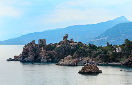 Cefalu old beautiful town surroundings coastal view with old ruined fortress, Palermo region, Sicily, Italy. Stock Photo