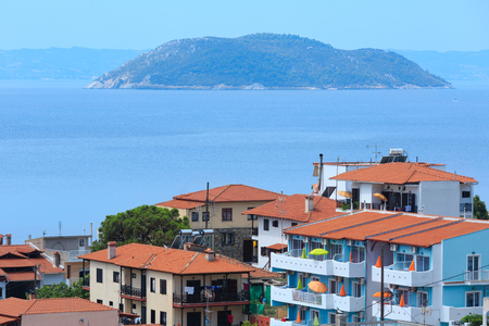 Summer morning top view on coastal Neos Marmaras village (Halkidiki, Sithonia, Greece).
