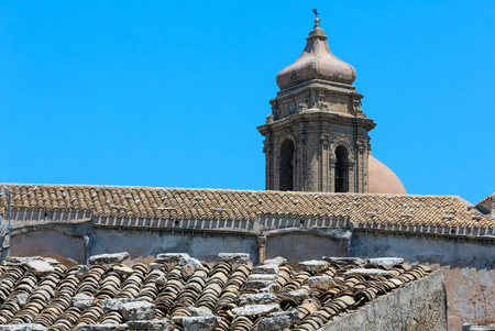 Bell tower of old Monastery San Salvador in medieval Erice town, Trapani region, Sicily, Italy.