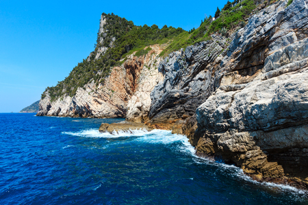 Beautiful rocky sea coast view from sea (Portovenere, near Cinque Terre, Liguria, Italy) Stock Photo